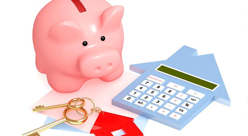 豚の貯金箱と家
